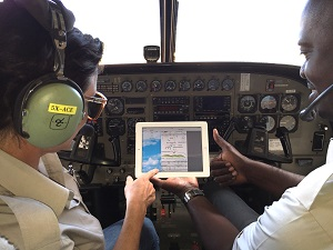 Pilots in plane looking at ipad