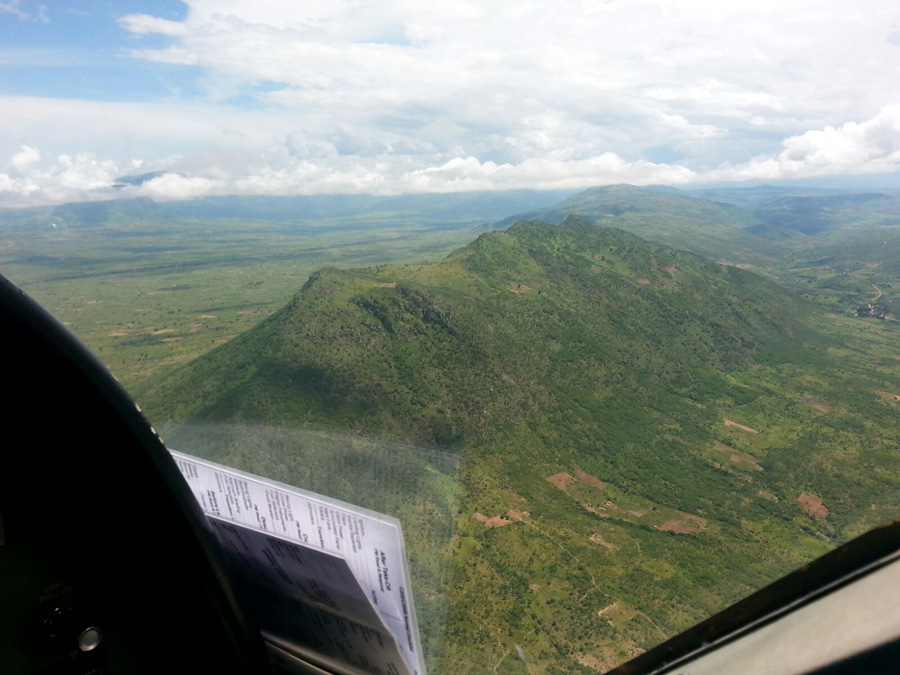 View of mountain region from plane