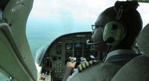 Pilot Flying Plane Looking Left