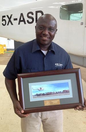Paul Ogwang Holding WFP Award