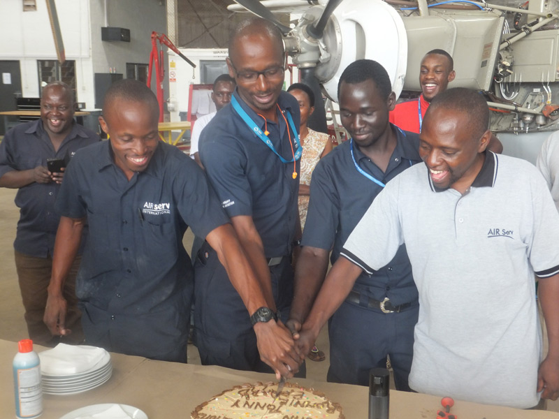Air Serv engineering team cutting cake